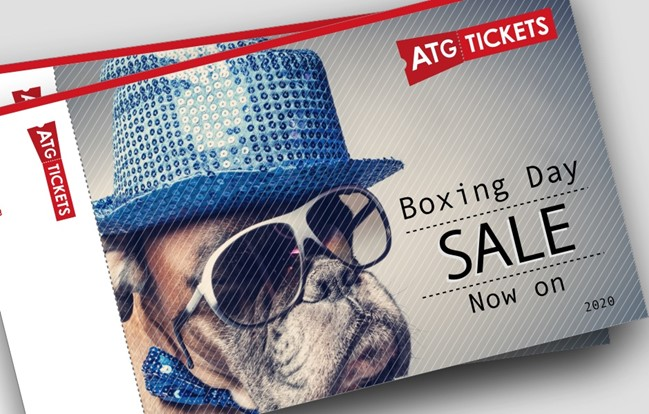 A dog wearing a top hat and sunglasses is on an ATG ticket