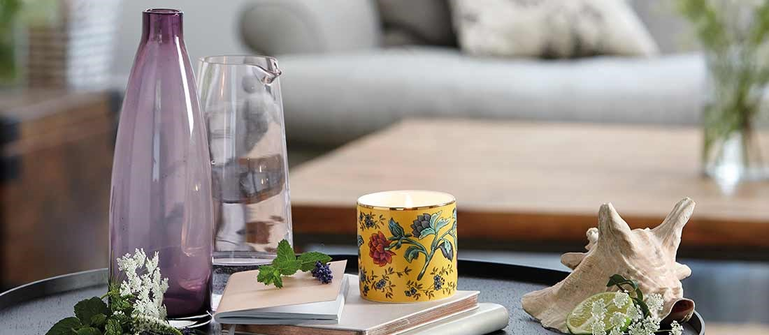 purple long stem vase with yellow printed exotic candle and seashell for Wedgwood lifestyle photoshoot