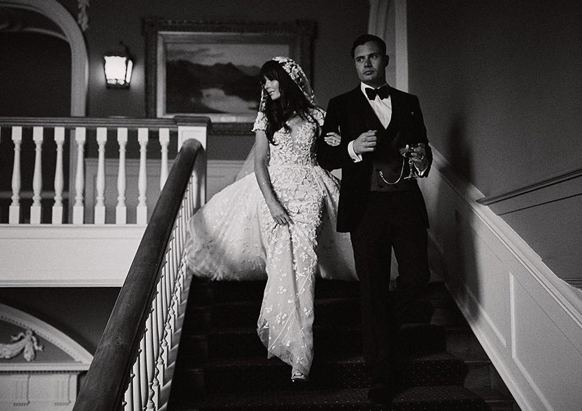 couple on their wedding day walking down the stairs