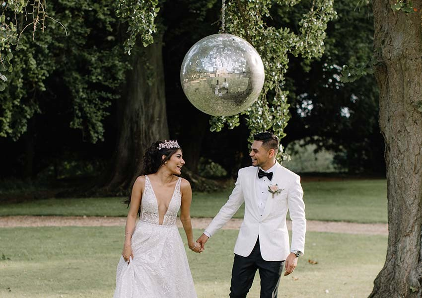 Bride and groom at Aynhoe Park wedding with outdoor disco ball