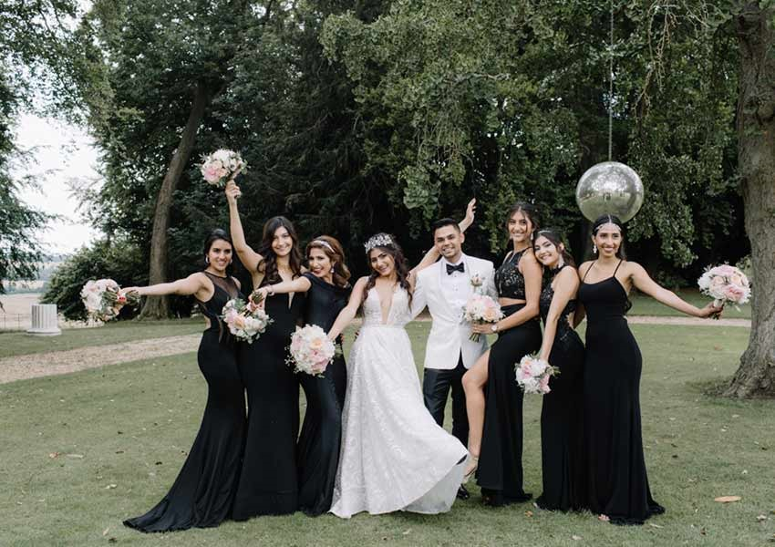 bride and groom posing with bridal party at Aynhoe Park