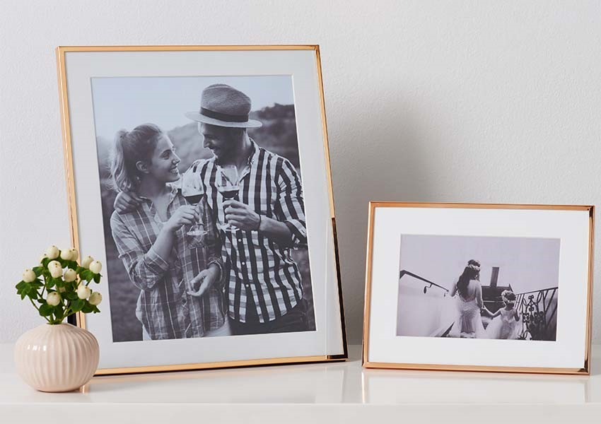 Copper photo frames at The Wedding Shop