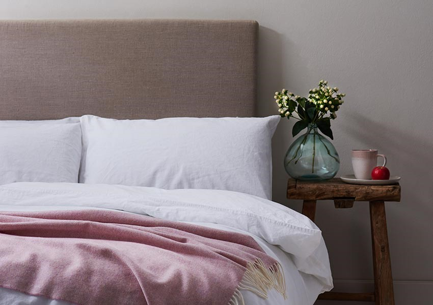 Soft bed linen with pink throw