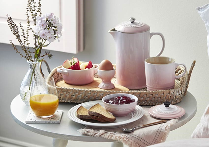 Soft pink shell Le Cruset for breakfast in bed