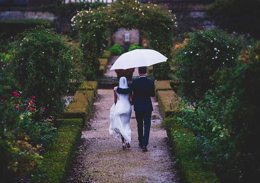 couple on wedding day in the rain