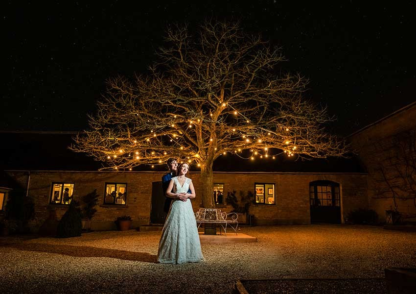 Winter wedding with fairy lights in the tree