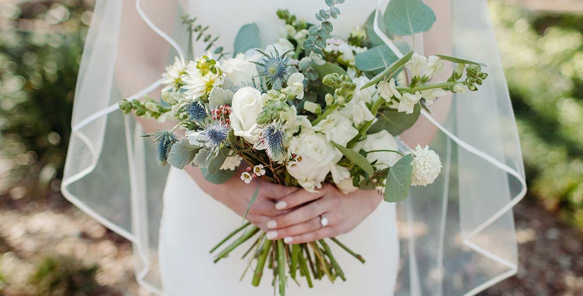 Stunning wedding bouquet with engagement ring