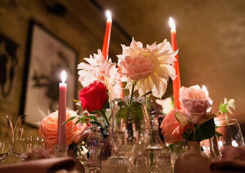 Pink and red wedding theme with candles and roses