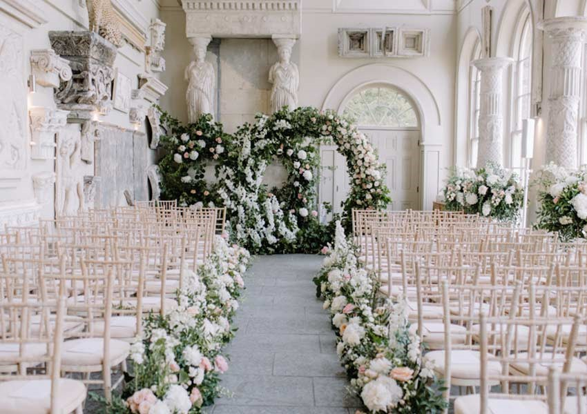 Aynhoe Park wedding ceremony seating and aisle with pink and white wedding flowers