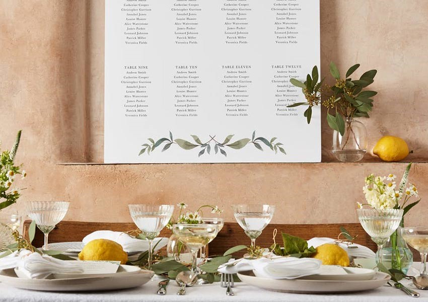 wedding table plan card with beautiful tablespace with lemons and champagne couples