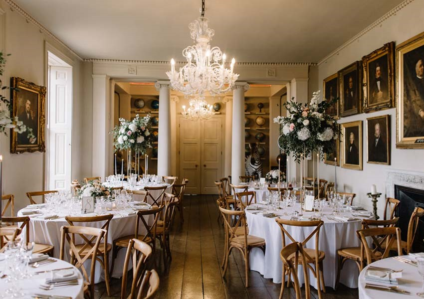 Aynhoe Park wedding reception room with beautiful chandelier