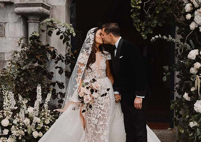 Newly-wed couple kissing