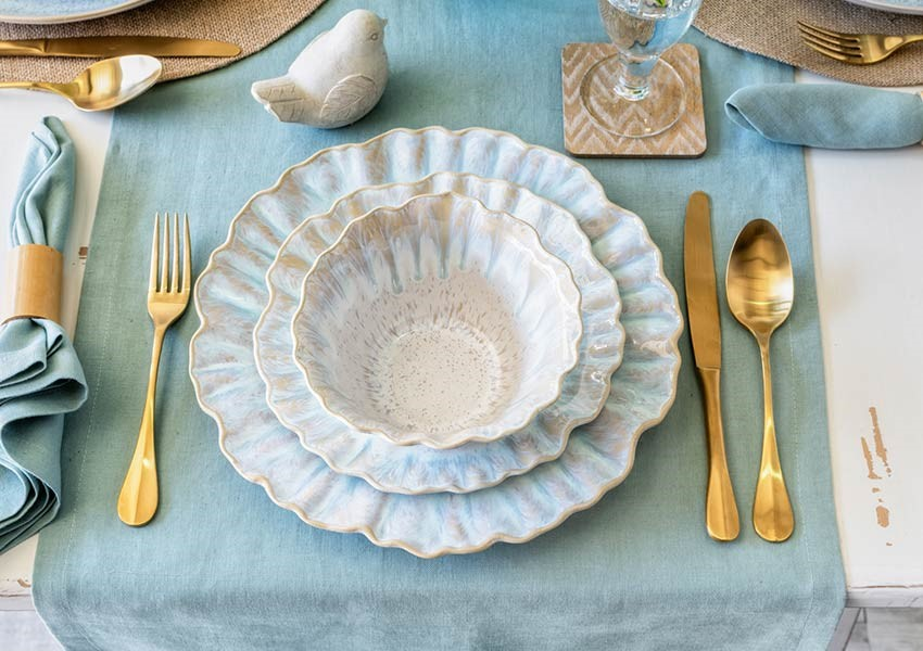 casafina tableware coated in a reactive glaze to create a stunning speckled effect in milky sand and sea tones, with simple, organic shapes in fine stoneware