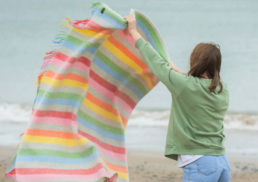 Rainbow striped tweedmill throw at beach