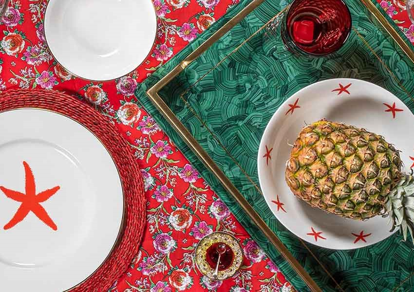 alice peto tropical star fish tableware with pineapple and red floral tablecloth