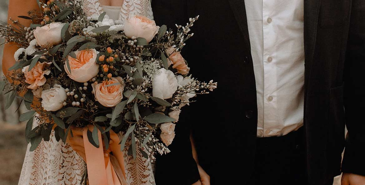 wedding flowers with peach and white roses and eucalyptus