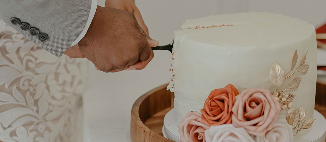 wedding cake with pink and peach flowers